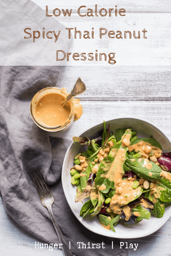 Everything there is to love about thai peanut sauce but with a low-calorie option! Low-Calorie Thai Peanut Dressing uses powdered peanut butter to bring creamy peanut butter taste with 85% less calories. Perfect for salads, on top of Thai dishes or as a veggie dip. An easy way to lighten up peanut butter! #powderedpeanutbutter #thaipeanutsauce