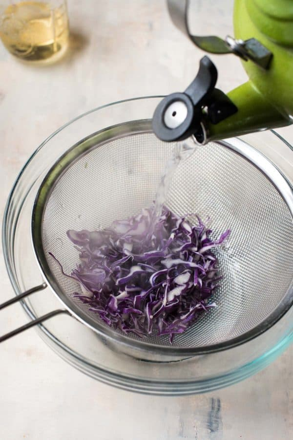steeping the sliced red cabbage to be pickled