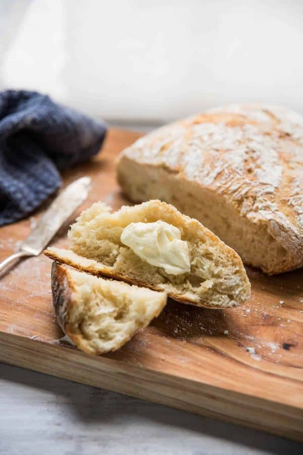 buttered pieces of fresh crusty no-knead bread