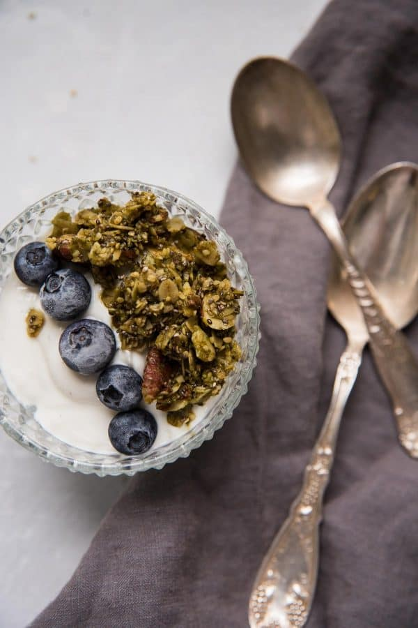 a bowl full of creamy yogurt, crunchy granola and fresh berries