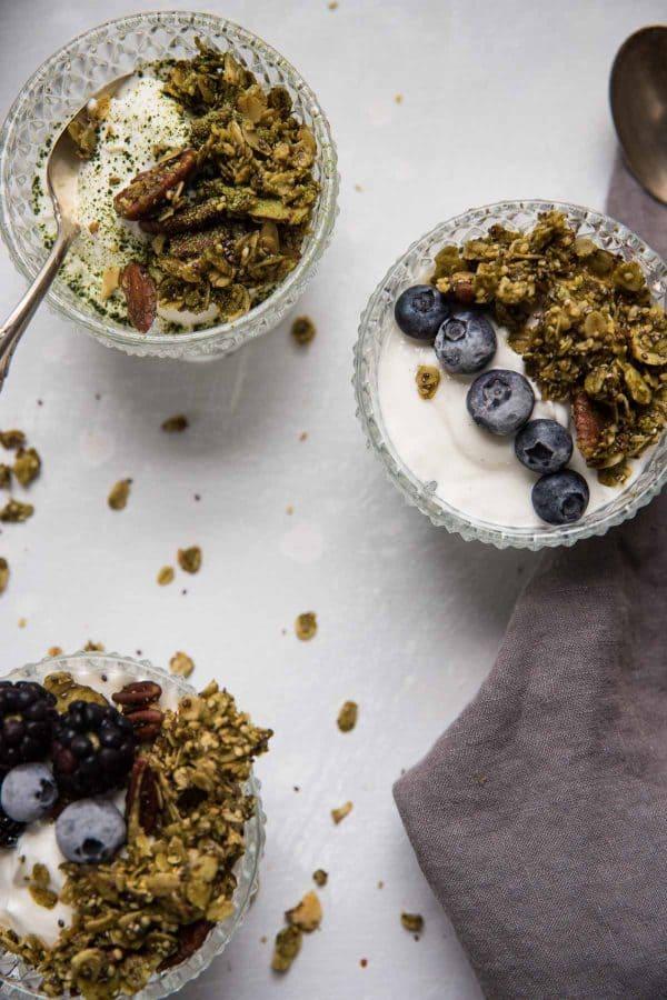 a bowl full of creamy yogurt, crunchy granola and fresh berries