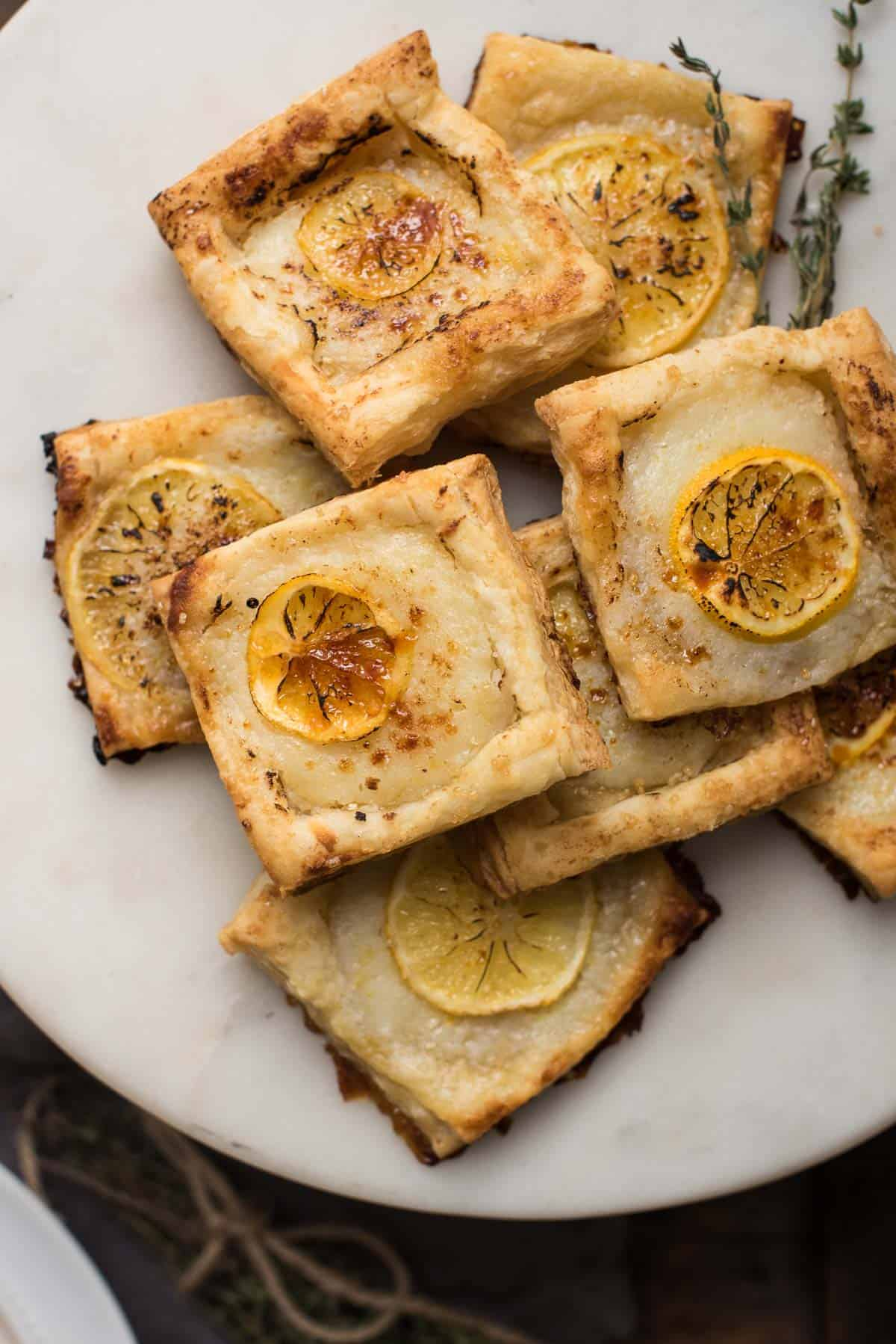 overhead view of meyer lemon ricotta pastries on a platter