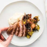 plated pan seared duck breast with cherry shallot wine sauce