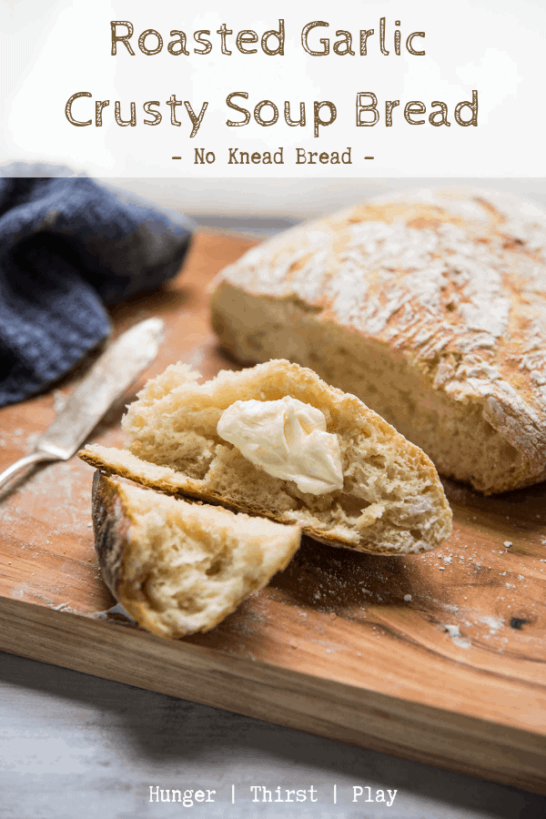 Tear into this easy no knead bread recipe in no time!  A quick bread recipe that creates a crusty, crunchy outside and tender, chewy sweet garlic dough inside.  This roasted garlic crusty soup bread is the perfect soup bread to dip and soak up broth or scoop ingredients!  The roasted garlic flavor makes this crusty bread recipe perfect for serving alongside a main dish too.  #noknead #breadrecipe #comfortfood