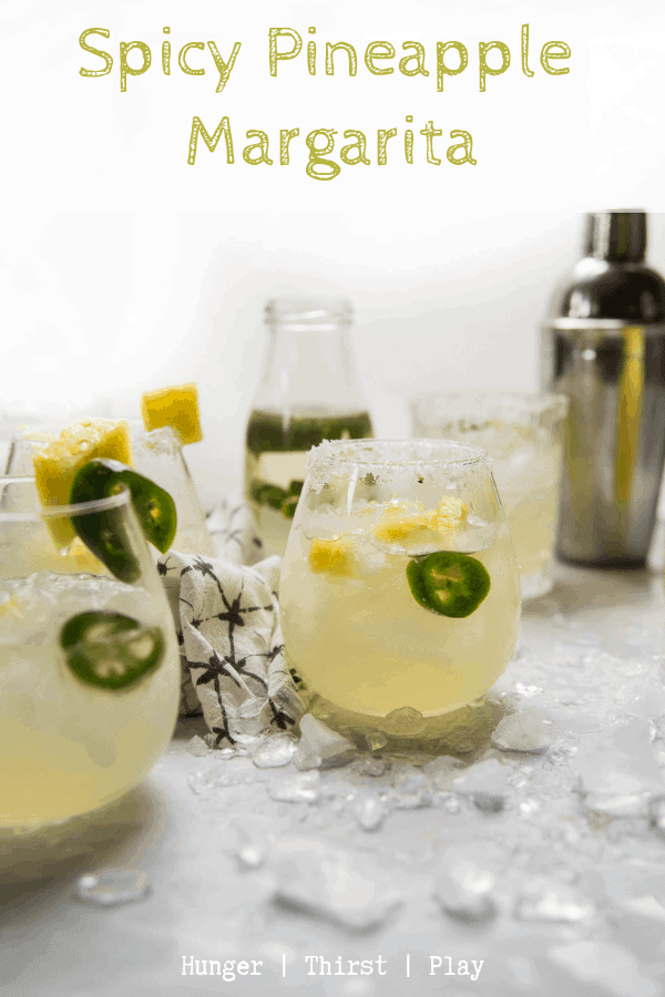 The best spicy pineapple margarita! Naturally infused pineapple tequila with super easy jalapeño simple syrup and a splash of lime makes for a well balanced, dangerously delicious spicy pineapple margarita. #margaritas #tacotuesday