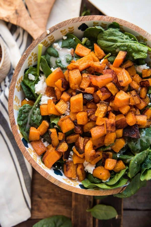 hot roasted butternut squash melts goat cheese and warms spinach in a bowl