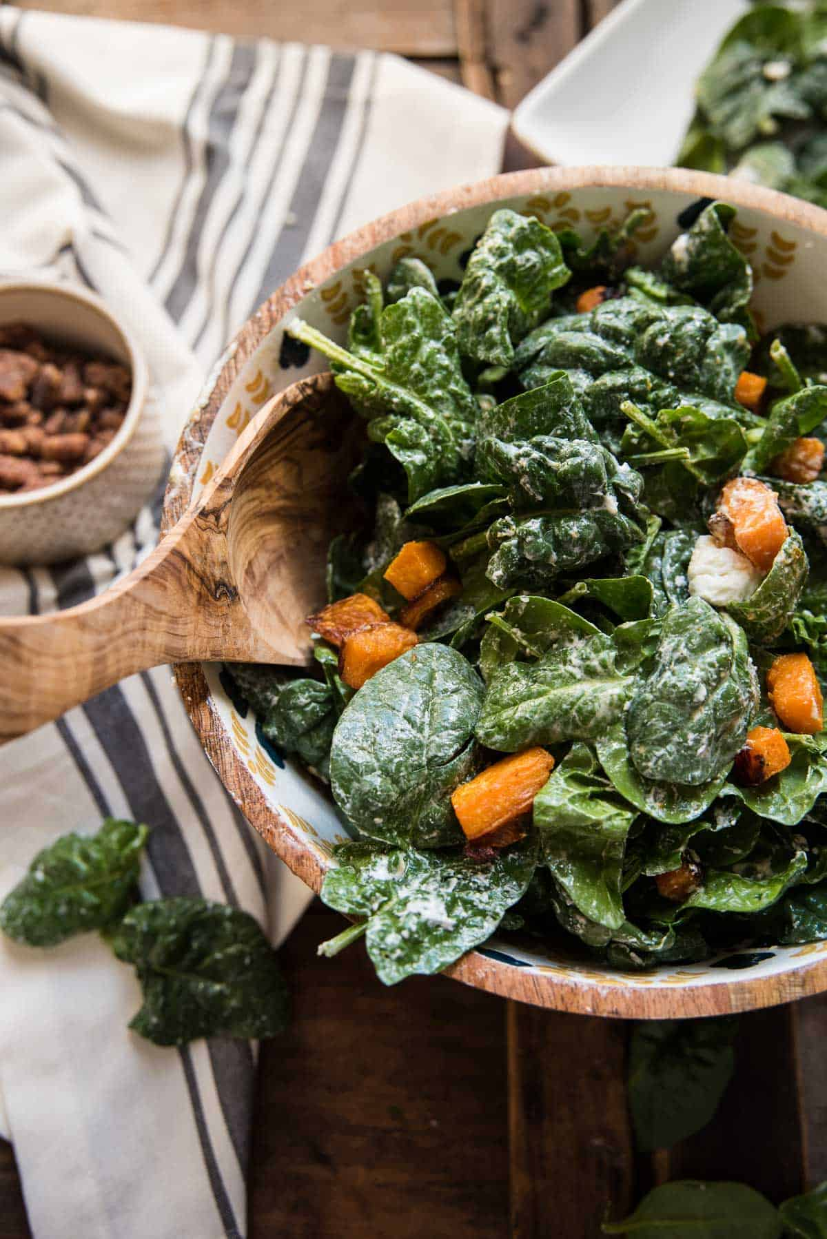 leafy spinach tossed with roasted butternut squash and warmed goat cheese