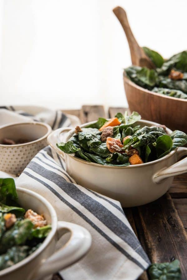 individual portions of warm spinach salad
