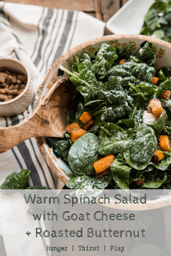 Warm spinach salad is chock full of healthy greens tossed in warm goat cheese and roasted butternut squash with your favorite salad dressing. Glazed pecans add a little sweetness. A perfect spring salad to bridge the gap between winter comfort food and healthy spring eats. #spinachsalad #warmgoatcheese