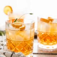 close up of earl grey lavender bourbon punch in tumblers