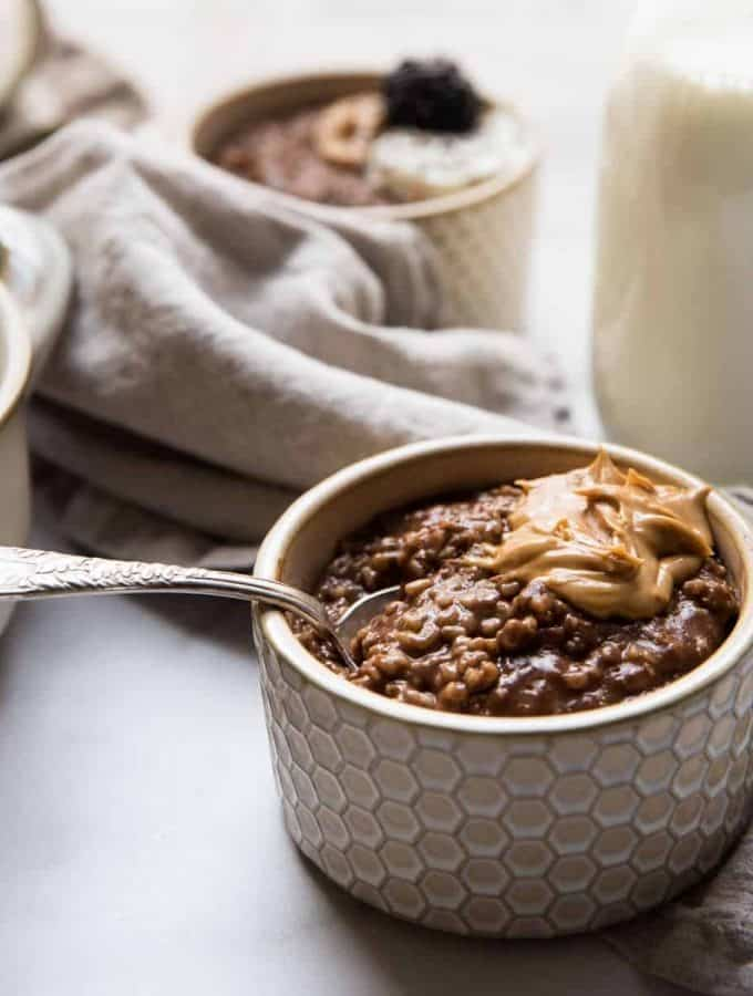 spoon resting in a bowl of chocolate steel cut oats