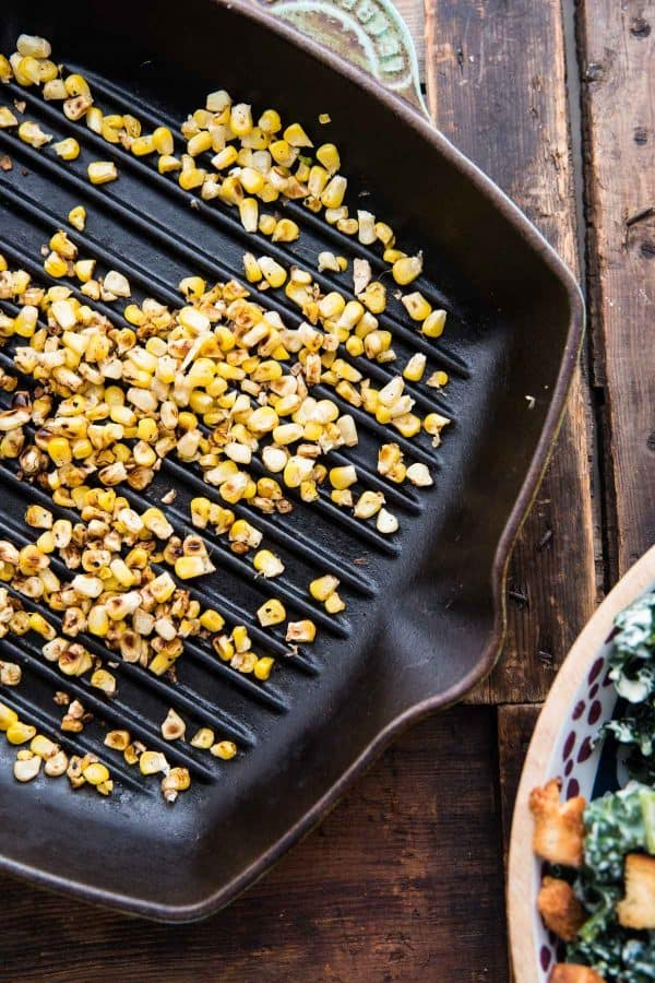 grilled corn kernels in a cast iron pan
