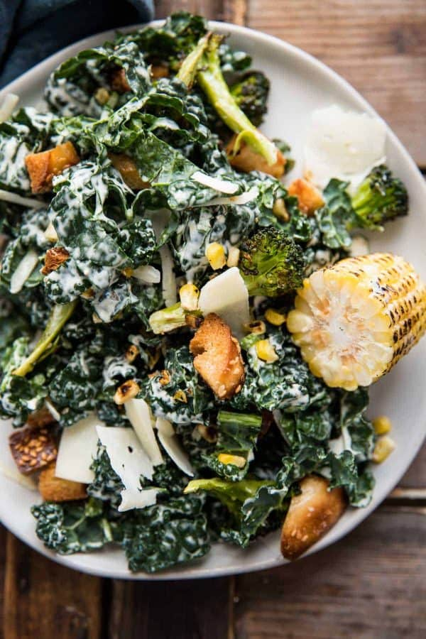 roasted broccoli and kale caesar salad on a plate