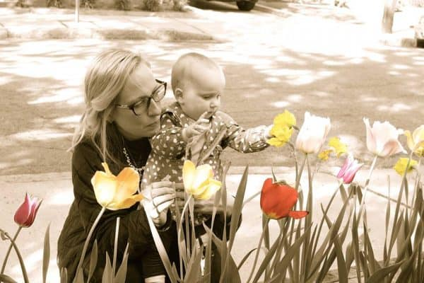mama and little girl in the spring tulips