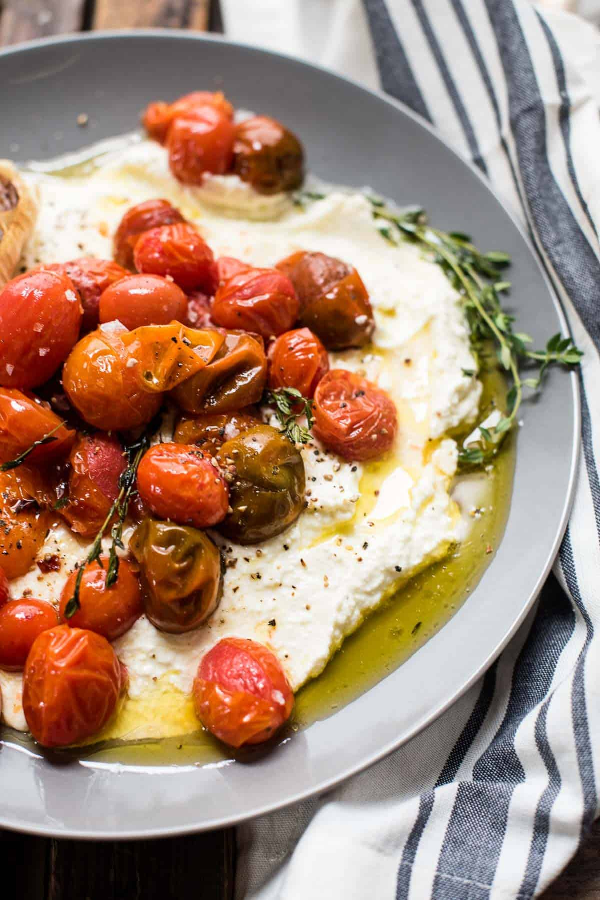 close up of whipped feta topped with roasted garlic olive oil