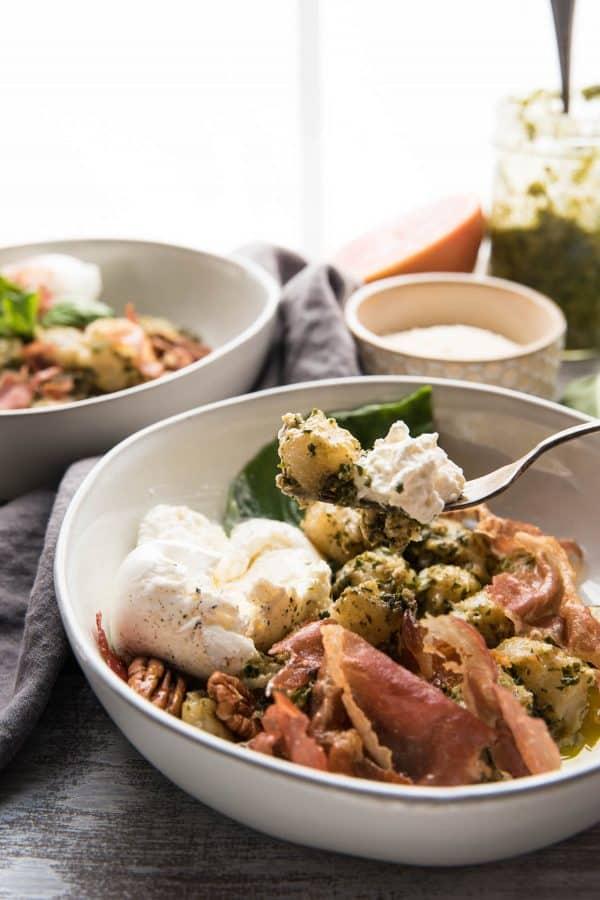 gnocchi and pesto with burrata on a fork