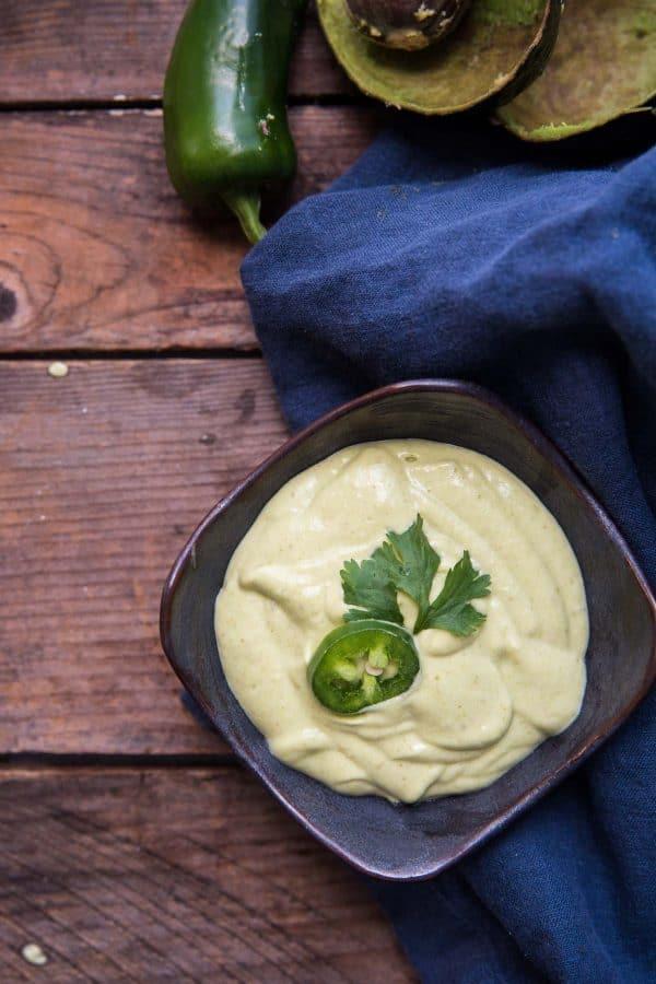 overhead of creamy jalapeno avocado crema