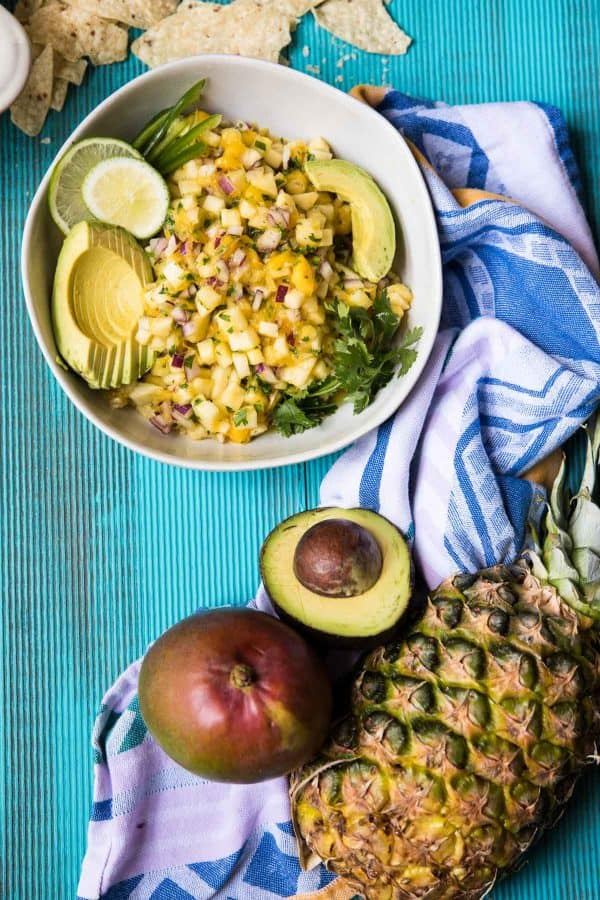 overhead view of pineapple mango salsa in a bowl with chips