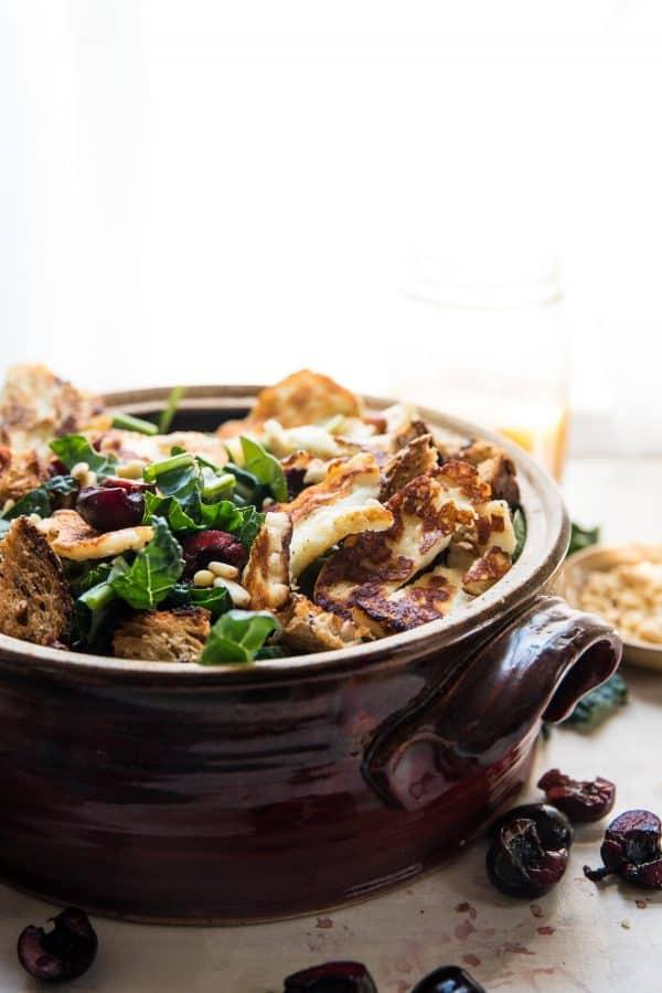salad bowl stuffed with fried halloumi, kale and fresh cherries