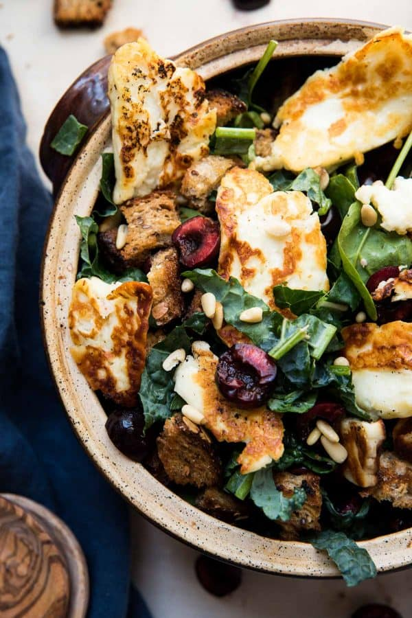 overhead view of fried halloumi over salad