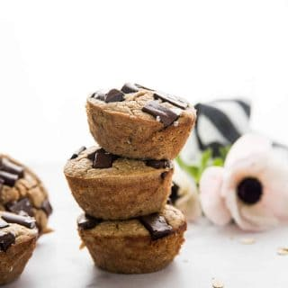 stack of peanut butter banana muffins with a flower in the background