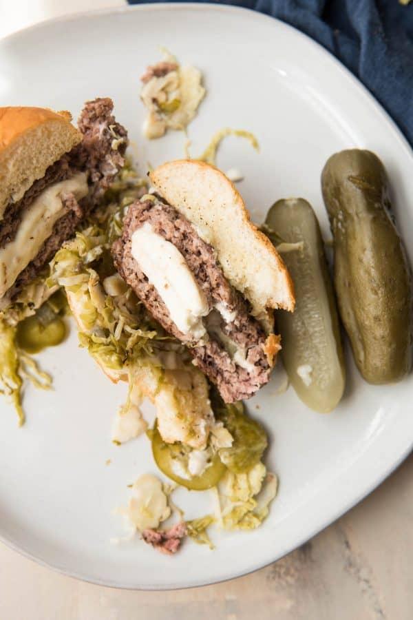 feta stuffed burger cut in half