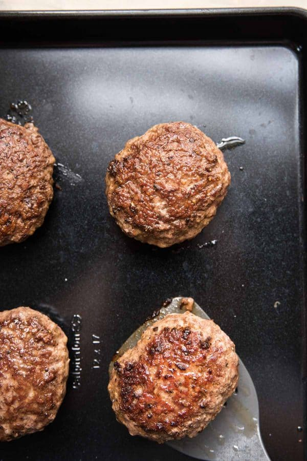 lamb burgers on a sheet tray