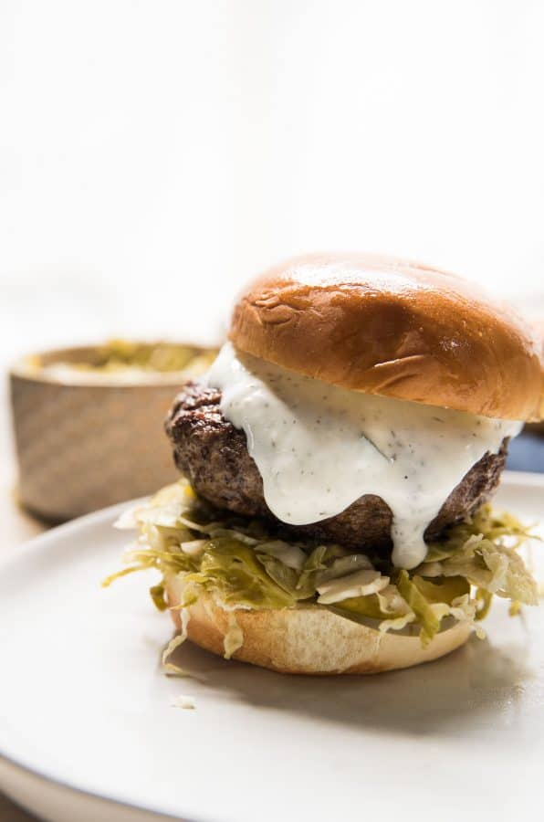 creamy tzatziki on ground lamb burger