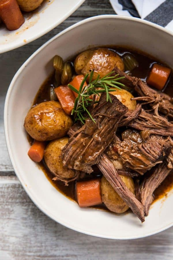 close up of serving of pot roast and veggies in a bowl
