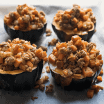 roasted stuffed acorn squash on a sheet tray