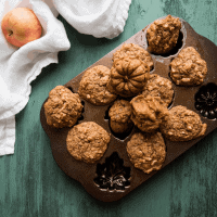 mini healthy apple cakes stacked on the fall themed baking pan