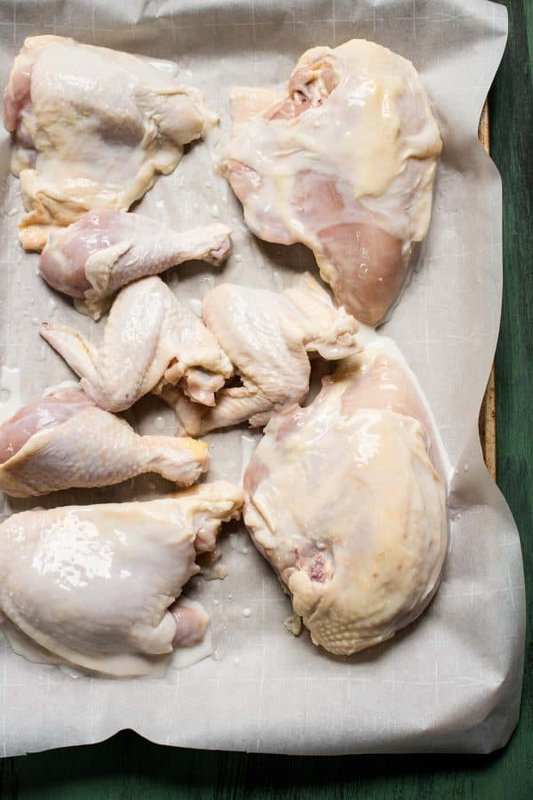 buttermilk marinated chicken on a roasting pan