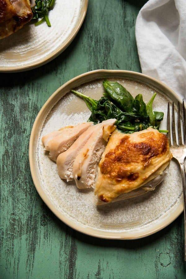 sliced chicken breast with spinch