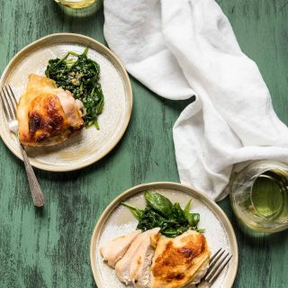 two plates of roast chicken with white wine