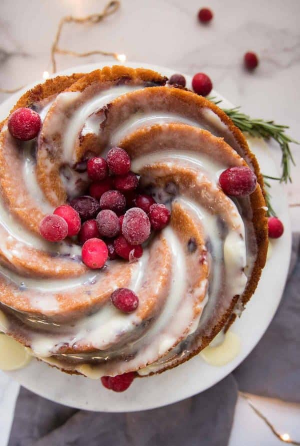 overhead angle of cranberry bundt cake with white chocolate drizzled over