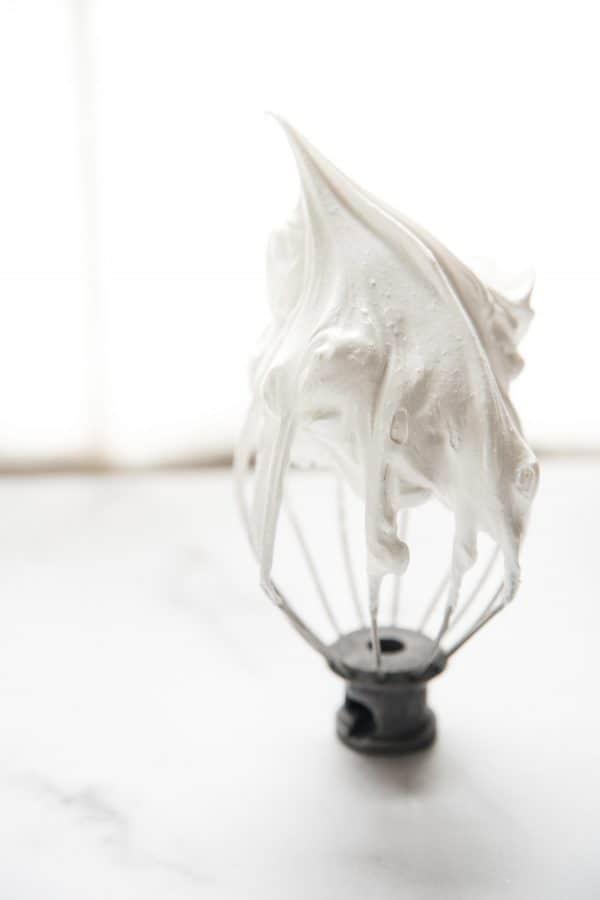 stiff peak meringue on a whisk