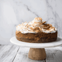 meringue topped gingerbread cheese on a cake stand