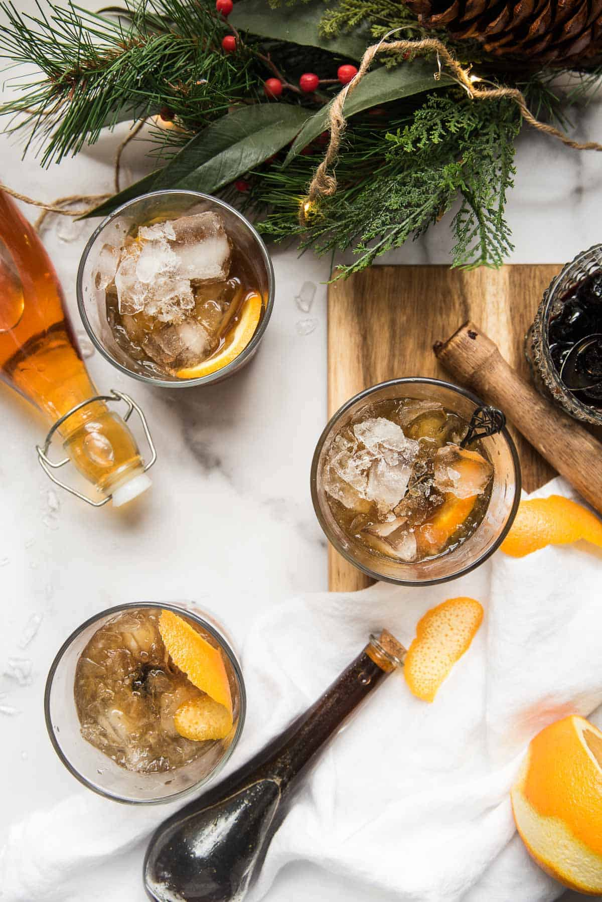 three glasses of gingerbread old fashioned
