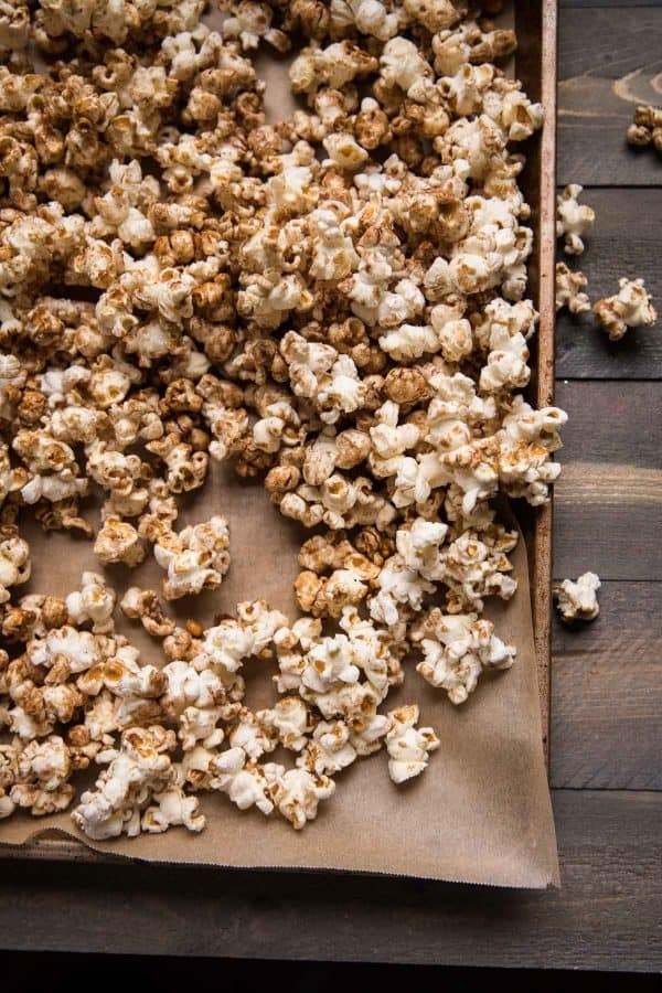 fresh popped gingerbread popcorn on a sheet pan