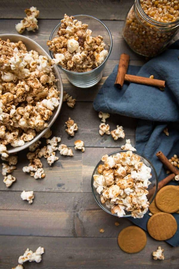 fresh gingerbread popcorn spilling out of the bowl