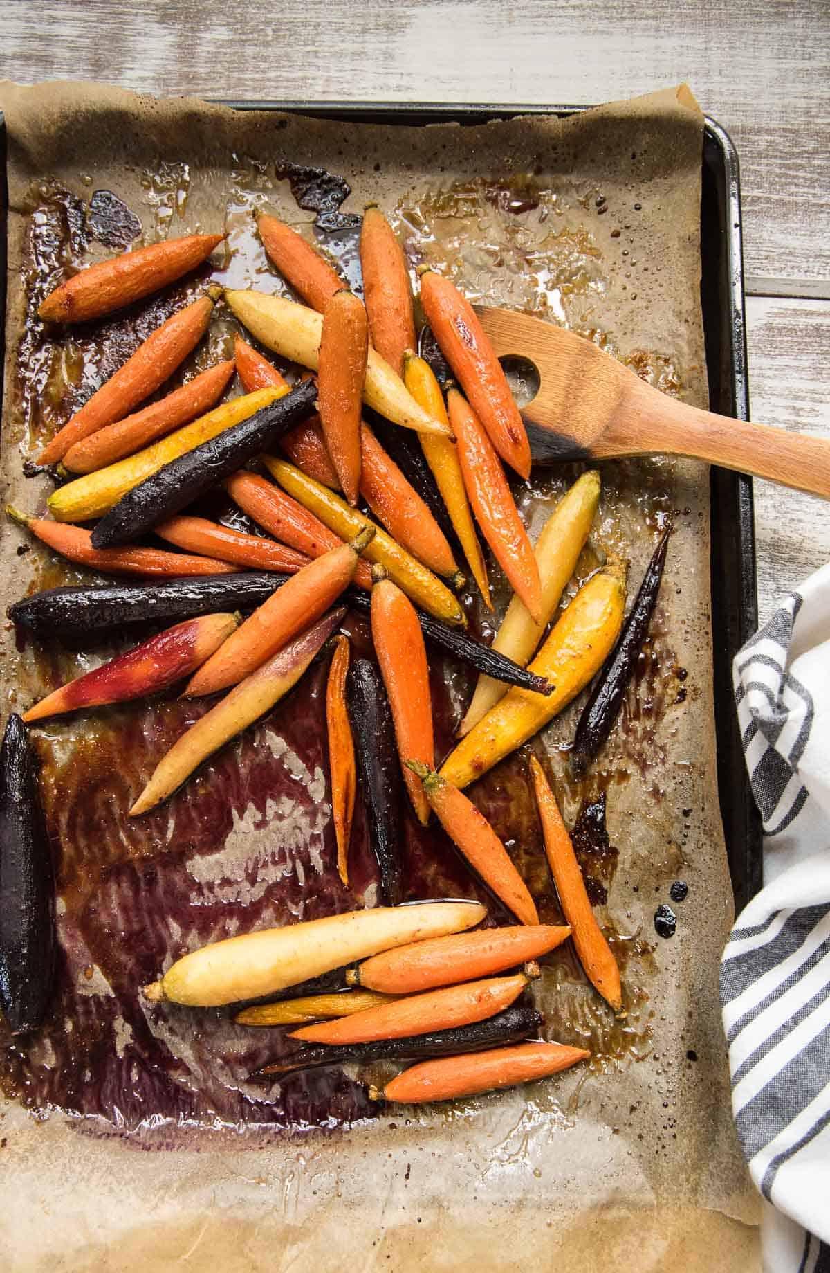 roasted rainbow carrots on a sheet tray