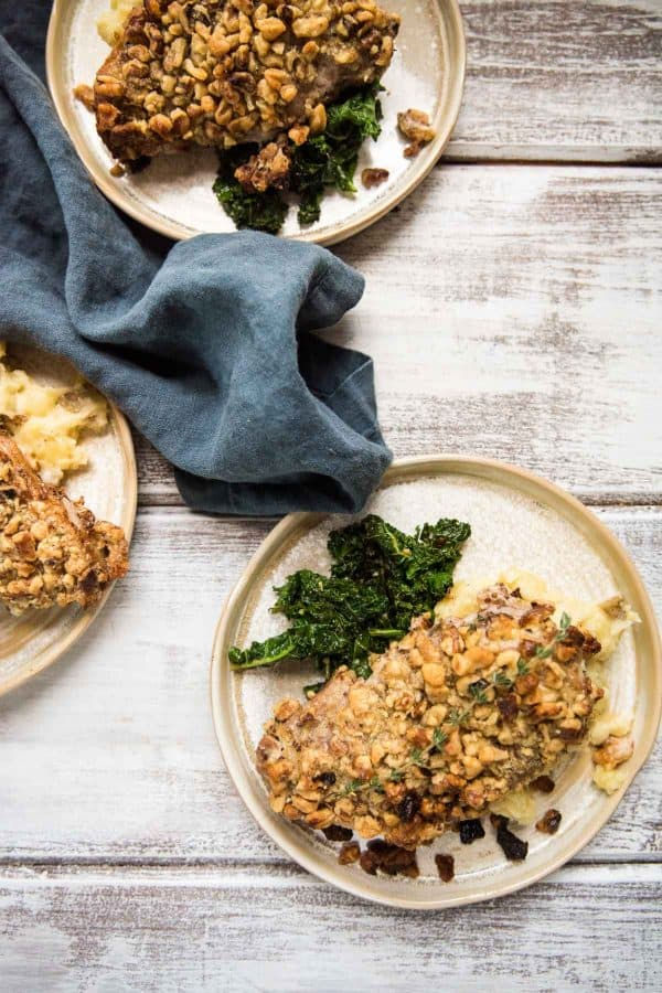 three plates with crispy pork chops, greens and mashed potatoes