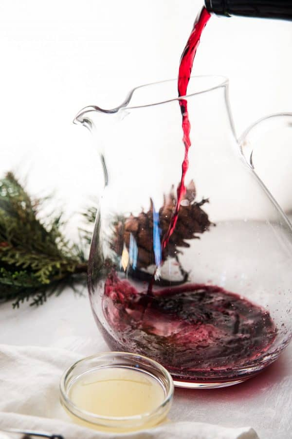 wine pouring into pitcher