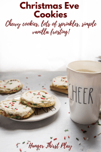 cookies for santa on a plate with a cup of milk