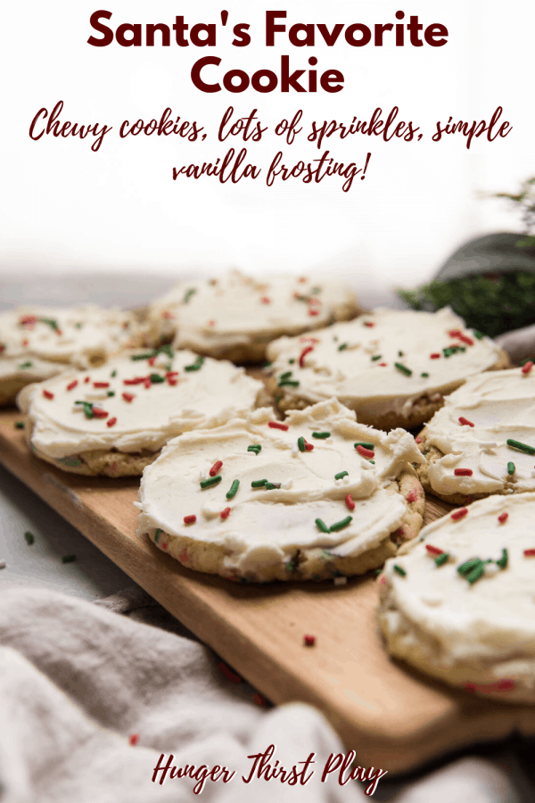 frosted cookies for santa on a wooden platter