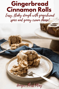 gingerbread cinnamon rolls on plates with forks