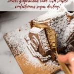 slicing gingerbread house cake