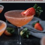 strawberry martini garnished with a fresh strawberry and sugar rim