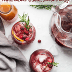 overhead angle of glasses of red christmas sangria and a pitcher