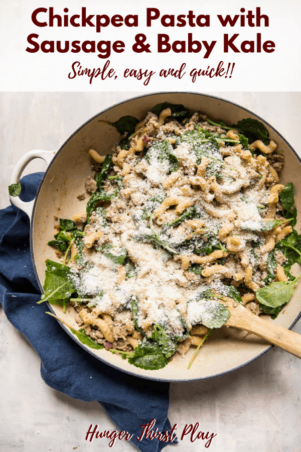 one pan meal of chickpea pasta with sausage, kale and parmesan cheese